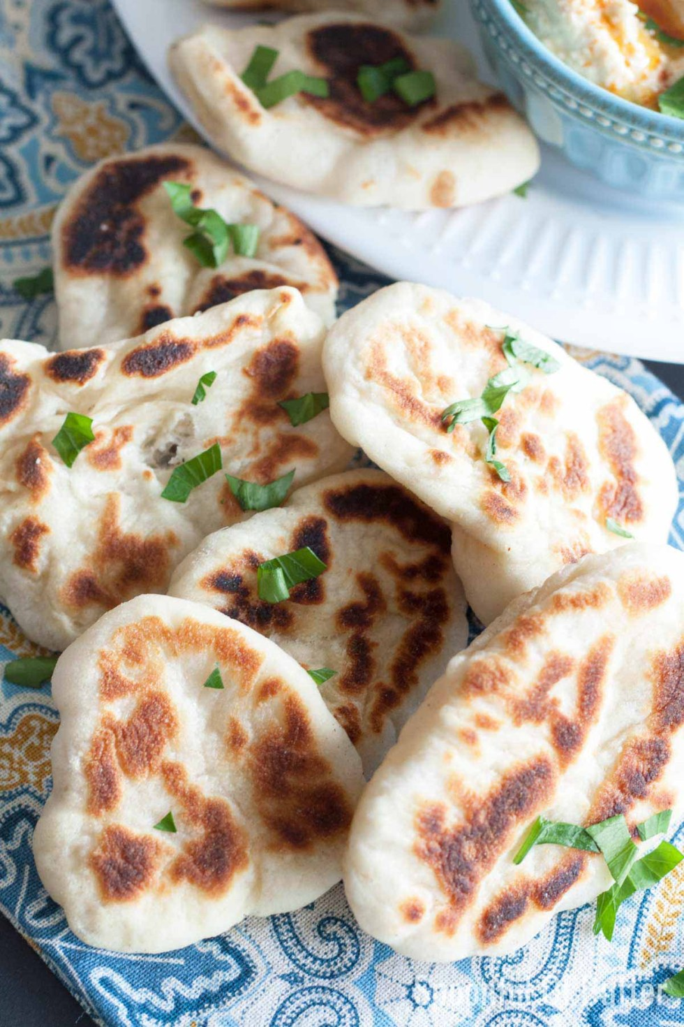 Soft and chewy Naan Dippers. The yogurt in the dough makes these bread flavorful. See those air pockets and char? Yes, they're quite awesome, especially with your favorite curry and dip. | www.SpoonfulOfButter.com