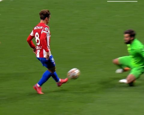 Alisson using his body to deny Griezmann  Class.   ...