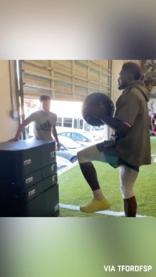 Single leg 42-inch box jump while holding a 15-pound medicine ball.  is somethin...