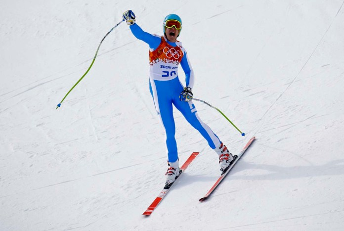 Italy's Innerhofer reacts after his men's alpine skiing downhill race during the 2014 Sochi Winter Olympics at the Rosa Khutor Alpine Center