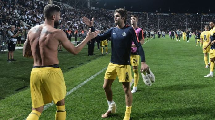 Olivier Giroud and Marcos Alonso celebrate the victory at PAOK
