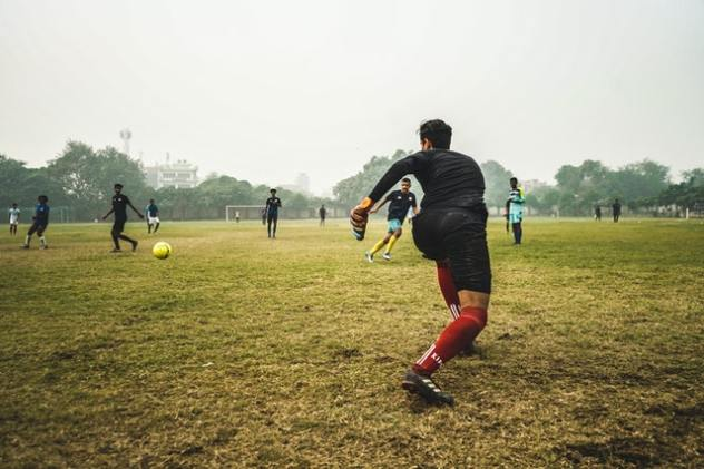 playing football on muddy field