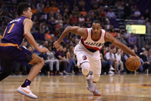 Portland's C.J. McCollum dribbles to the basket.