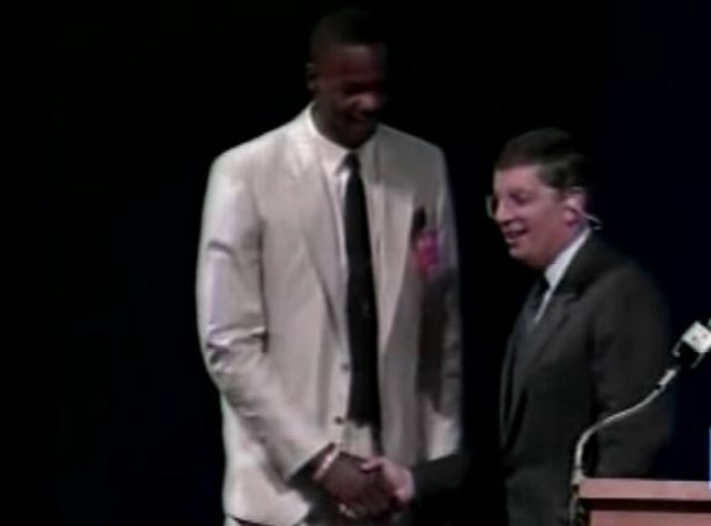 Len Bias stands on stage during draft day with commissioner David Stern.