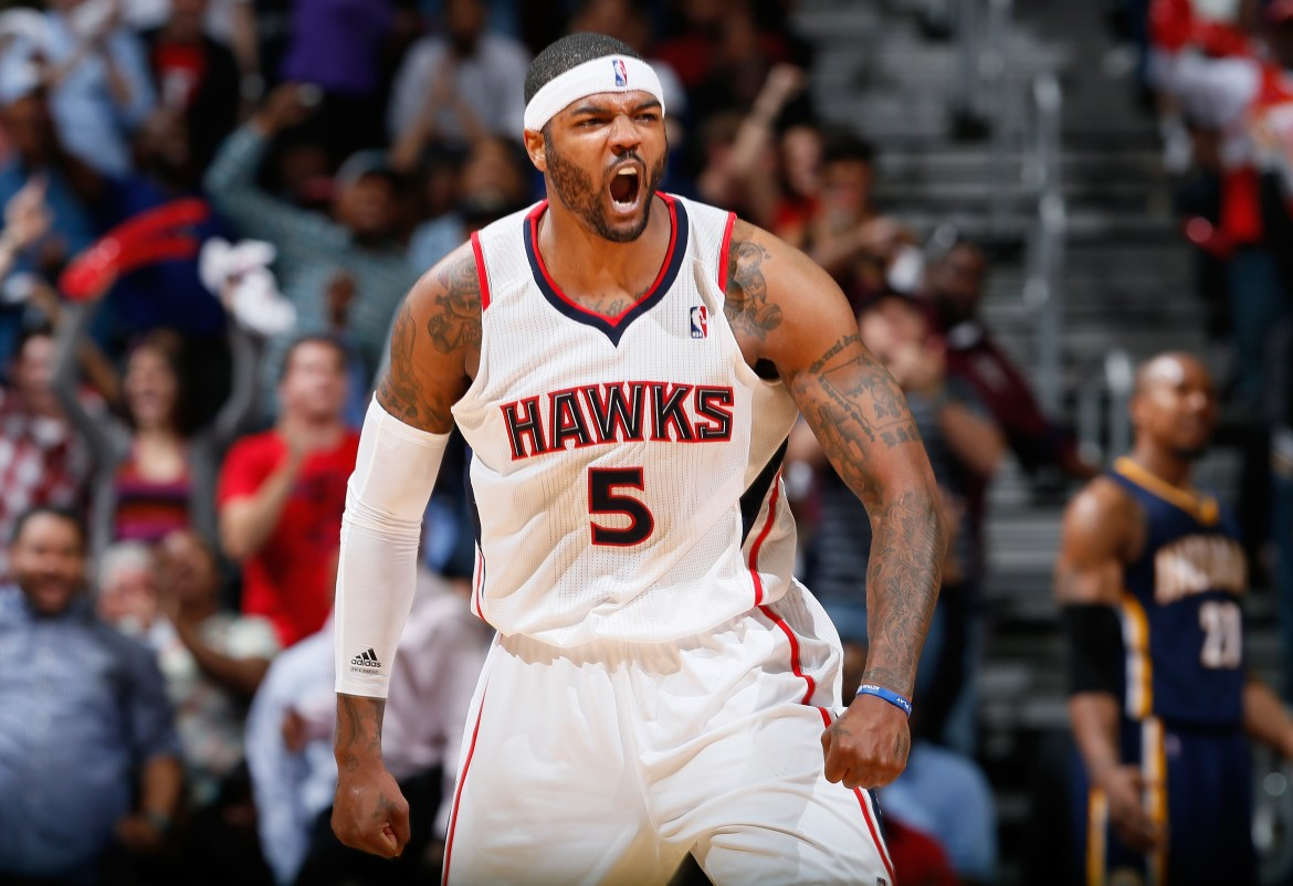 Josh Smith celebrates after taking a shot during a Hawks game