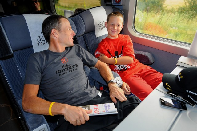 Lance Armstrong riding bus with son Luke