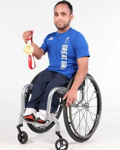 Sport For Champions athlete, motivational speaker and ambassador Ayaz Bhuta parades the gold medal that he won in Tokyo's 2020 Paralympic Games at the Wheelchair Rugby event with his teammates.