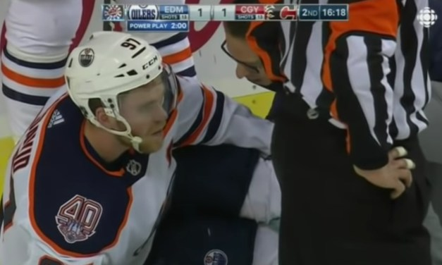 Oilers Star Connor McDavid Helped Off the Ice After Injuring Leg Crashing into the Net