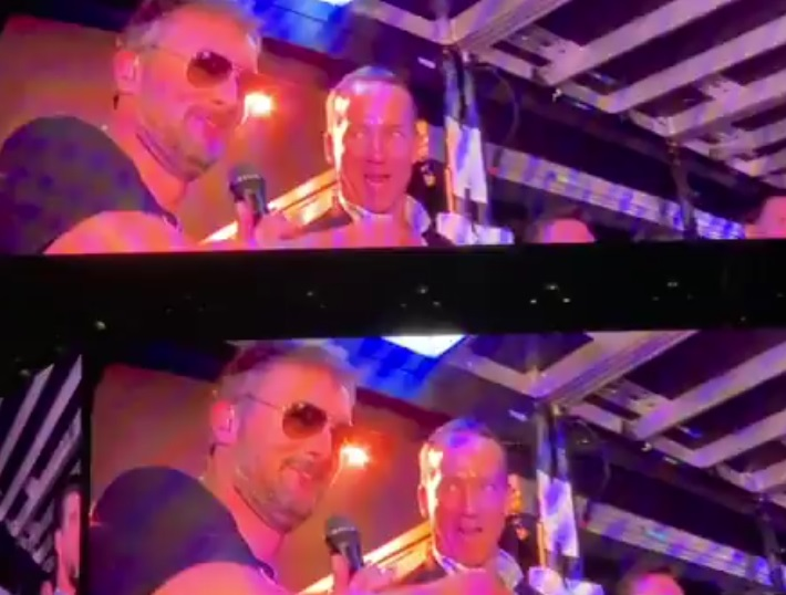 Peyton Manning and Michael Phelps Do Shots of Jack Daniels On Stage At Concert