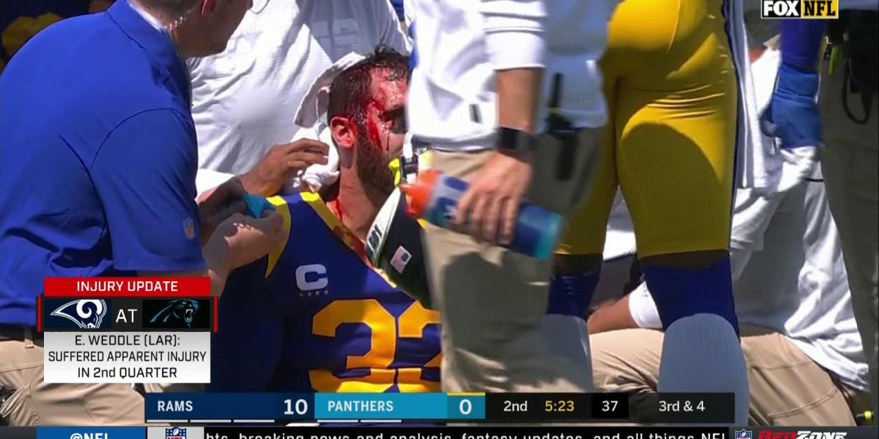 Rams Safety Eric Weddle Carted Off the Field After Being Kneed in the Head by Christian McCaffrey