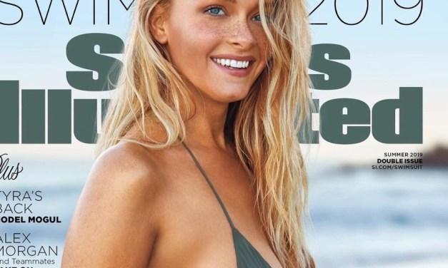 Camille Kostek Hard at Work Selling SI's Swimsuit Calendar