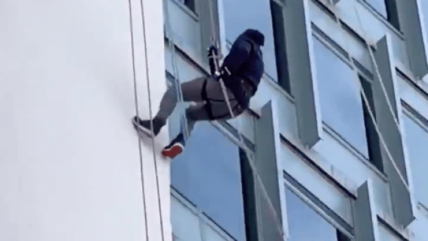 Yankees GM Brian Cashman Rappelled Down a Building and Passed By a Gerrit Cole Sign