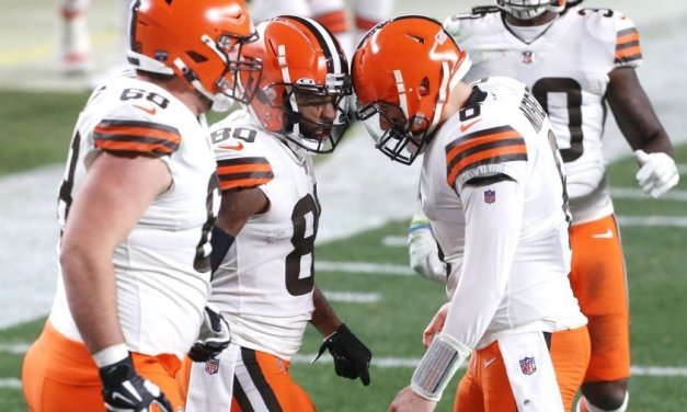 Browns get elusive playoff win, not 'satisfied yet'