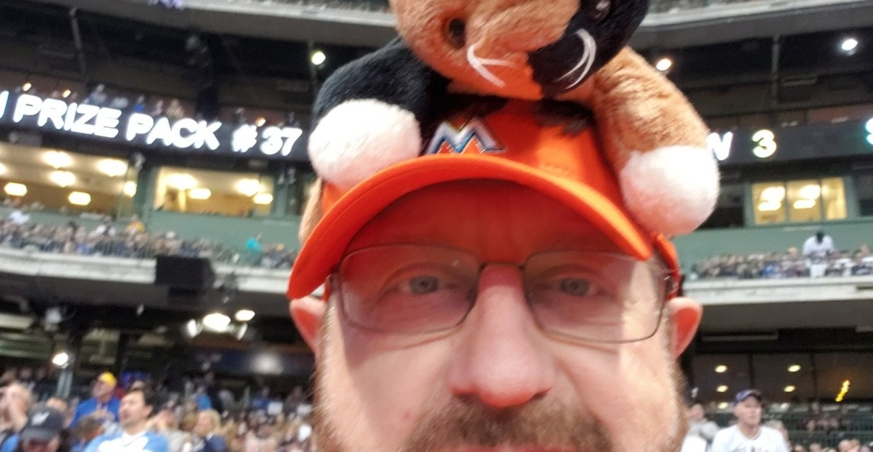 Marlins Man and His Rally Cat Sat Next to Front Row Amy During Game 1 of the NLCS