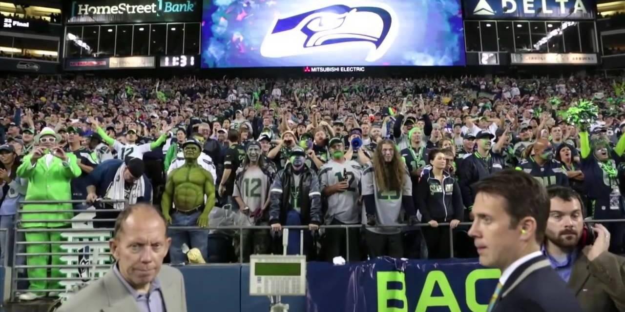 "Guy in a Seahawks Jersey Forgot What Bandwagon He Was on Caught on Camera Chanting ""Go Pack Go"""