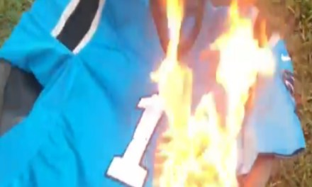 Panthers Fan Burns Cam Newton's Jersey Because He Dresses Like a Pimp