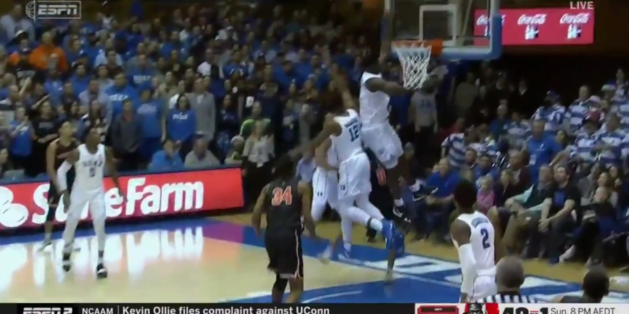 Zion Williamson Gets Up So High for a Block He Hits His Head on the Glass