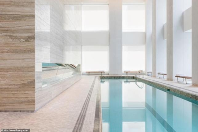 7980152-6580311-Fresh_The_penthouse_has_a_75_foot_indoor_swimming_pool_set_in_a_-a-33_1547186903112_MTYxMjA1NzU2MDMxNDExNzAx