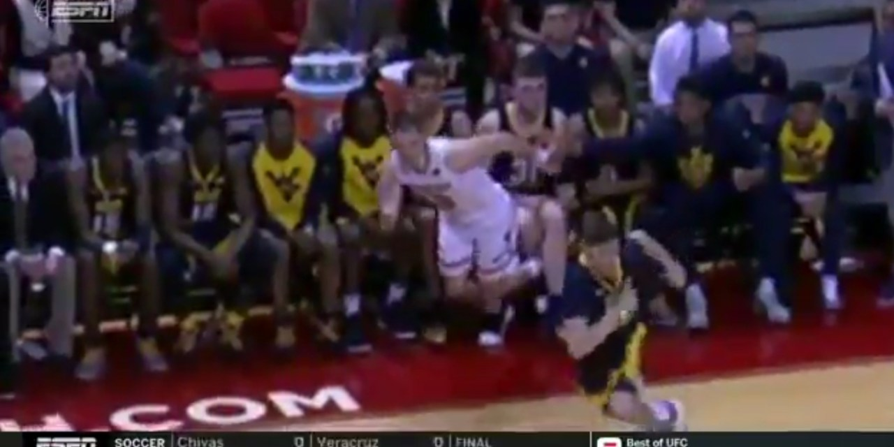 West Virginia's Logan Routt was Ejected for Tripping an Opponent from the Bench