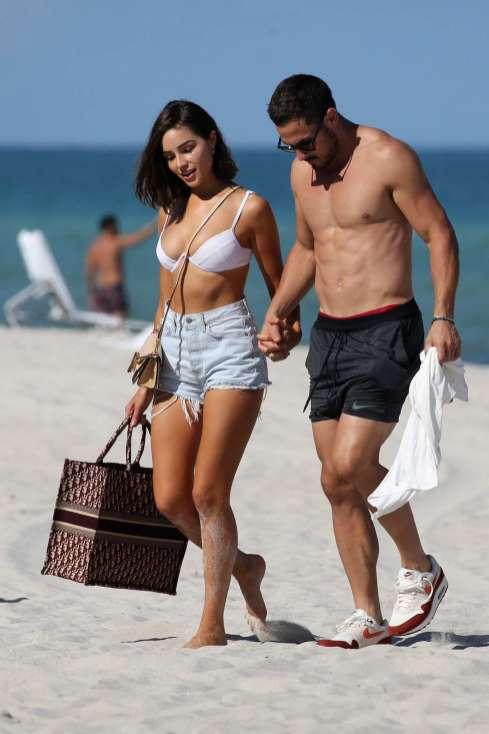 olivia-culpo-rocks-a-white-bikini-while-enjoying-the-beach-with-boyfriend-danny-amendola-in-miami-florida-250918_12_MTYyMDIxOTc3NzkwNDkwMjM3