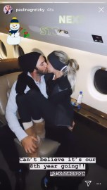 paulina-gretzky-kisses-dustin-johnson-proving-all-is-well-as-they-celebrate-8-years-together-gal_MTYyMjAyNjI0NjUxOTYyMDE0