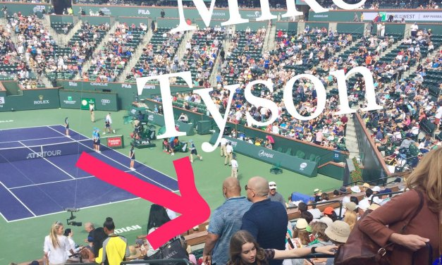 Mike Tyson Takes in a Match at the BNP Paribas Tennis Open