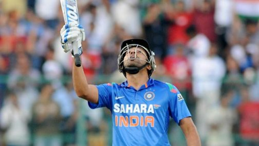 Indian-player-Rohit-Sharma-lifts-his-bat-to-celebrate-his-century-during-the-7th