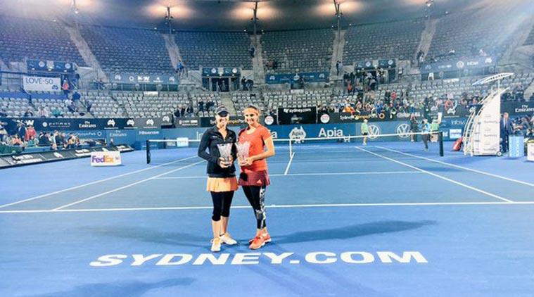 and Martina Hingis win Sydney International title