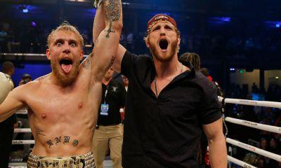 Jake Paul celebrating his victory with Logan Paul