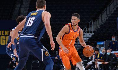 Denver's Jokic guarding Booker