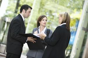 three_business_people_talking