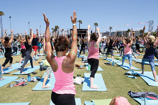 Major League Baseball incorporated a yoga event as part of its 2016 All-Star Game week of festivities in San Diego. The event attracted an estimated 2,500 participants, many of whom were women and children. Photo courtesy of Major League Baseball