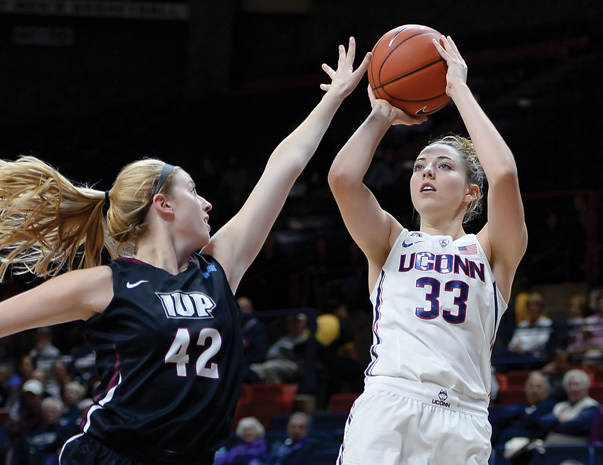 Katie Lou Samuelson (right) and the University of Connecticut have dominated NCAA's women's basketball. The team won the last four championships and extended its winning streak beyond 100 games this season. Photo courtesy of Jessica Hill/AP Images