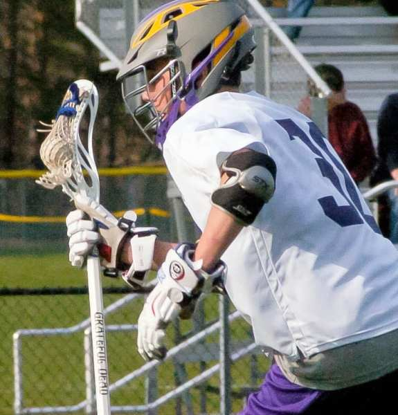 Voorheesville's Shawn LedDuke carries the ball upfield during a Colonial Council game against Maple Hill Wednesday, April 13. Rob Jonas/Spotlight