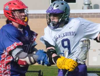 Voorheesville's Jake Palmer tries to run past a Maple Hill midfielder during the first quarter of a Colonial Council game Wednesday, April 13. Rob Jonas/Spotlight