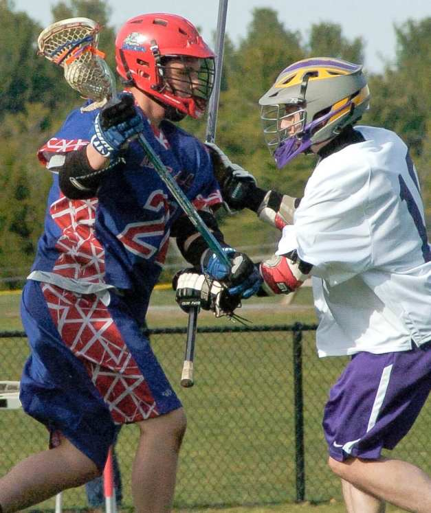 Voorheesville's Gabriel DeFreest-Rondeau defends Maple Hill's Nick Morris during the first quarter of a Colonial Council game Wednesday, April 13. Rob Jonas/Spotlight