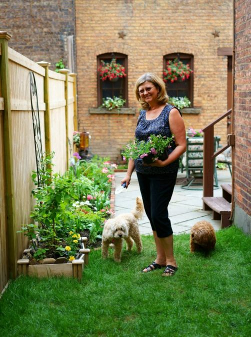 Karin Krasevac-Lenz in her hidden downtown Troy garden. Photo by Mike Brown / Imagination Photography Graphics