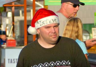 """Some fans got into the holiday spirit at the Tri-City ValleyCats """"Christmas in July"""" game against the Connecticut Tigers Thursday, July 14, at Joseph L. Bruno Stadium. Rob Jonas/Spotlight"""