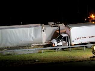 A large box truck spun around and flipped over near the Beaver Dam Road overpass on the New York state Thruway in Selkirk on Tuesday evening, Nov. 22. No injuries were reported. (Photo by Thomas Heffernan, Sr.)