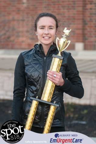 Leah Triller holds on to her first place trophy.