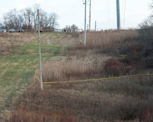 Police tape along the hillside behind Hoffman Car Wash (Photo by Jim Franco/Spotlight News)
