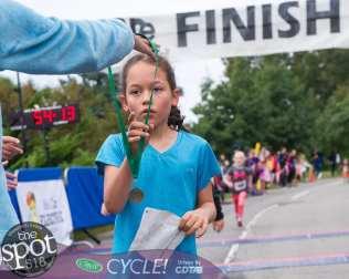 A runner during last year's CYC 5K gets a medal. Jim Franco/Spotlight News