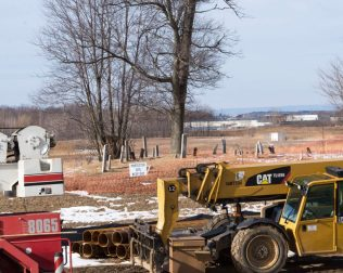 Construction machinery along the Northway with the Wolf Kemp Cemetery in the background. Jim Franco / Spotlight Newspapers