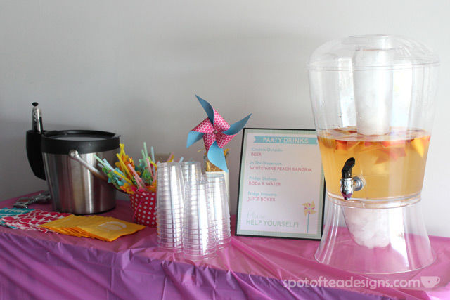 Pinwheel first birthday party: Drink Party station with signs to direct guests to other drinks. #birthdayparty | spotofteadesigns.com
