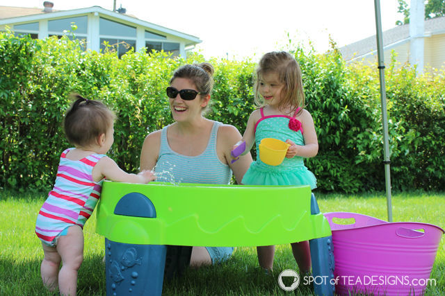 3 Fun Outdoor Activities for Toddlers this summer - Make your own colored ice for water table fun. #ad #TopYourSummer #SoHoppinGood  spotofteadesigns.com