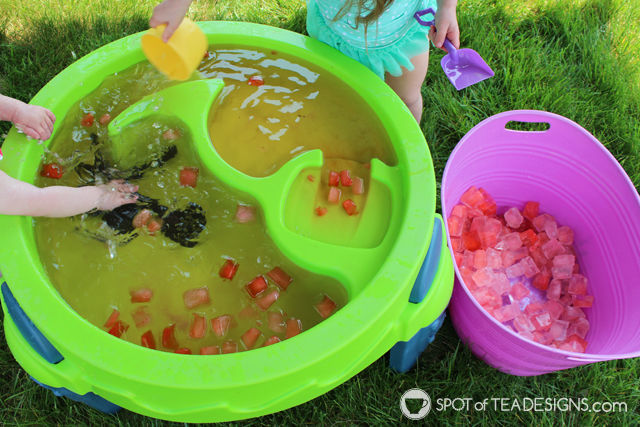 3 Fun Outdoor Activities for Toddlers this summer - Make your own colored ice for water table fun. #ad #TopYourSummer #SoHoppinGood |spotofteadesigns.com