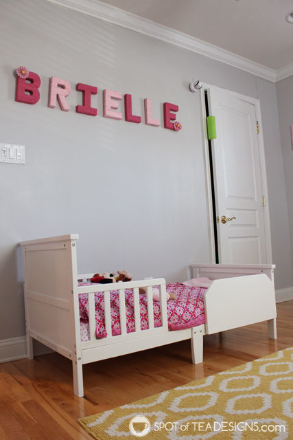 Pink and Yellow Toddler Bedroom Tour - yarn wrapped letters over toddler bed | spotofteadesigns.com