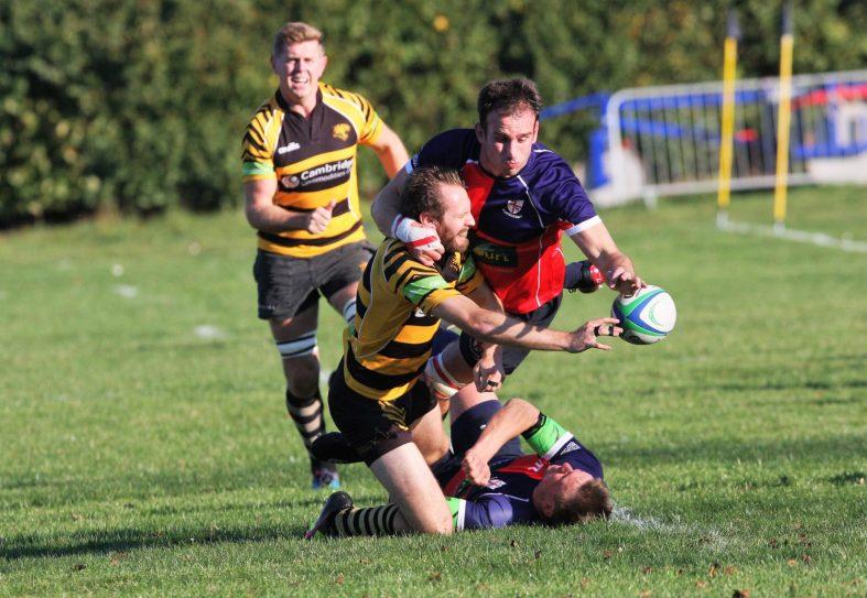 Joel Scott-Paul releases the ball under pressure