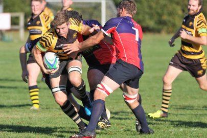 John Dibb brings the ball away