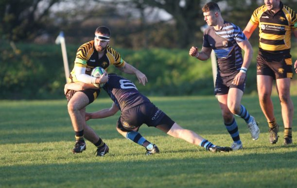Tom Green tries to miss a tackle